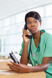 Nurse on the phone at work station Stock Image