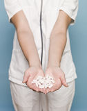 Nurse with pills Stock Images