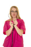 Nurse in pink outfit with stethoscope look crazy Stock Photos