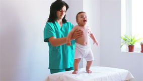 Nurse playing with a baby in hospital Royalty Free Stock Images