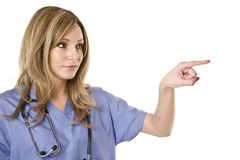 Nurse pointing isolated on white Stock Photos
