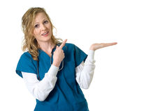 Nurse pointing to blank space Royalty Free Stock Image