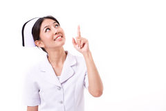 Nurse pointing up Stock Image