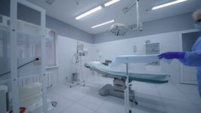 Surgery room in surgery. Nurse prepares surgical room for surgery stock footage
