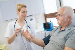 Nurse preparing device attached to finger stock photo