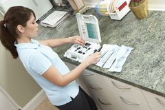 Nurse Preparing Equipments For The Doctor Stock Photography