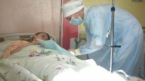 Nurse preparing female patient arm to put IV tube stock footage