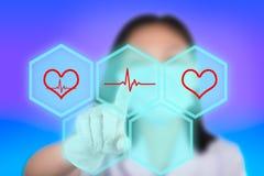 Nurse pressing cardiogram buttons show cardiology technology.  Stock Image