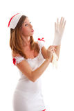 Nurse pulls medical gloves. Young sexy nurse pulls medical gloves Royalty Free Stock Photos