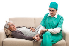Nurse pulse check old woman laying at bed Stock Photo