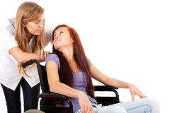 Nurse is pushing her patient on a wheelchair Royalty Free Stock Images