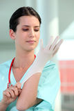 Nurse putting on gloves Royalty Free Stock Images