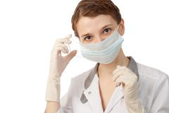Nurse putting on mask Royalty Free Stock Photos
