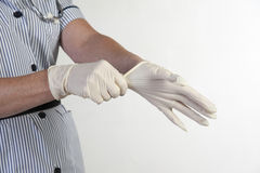Nurse putting on protective gloves Stock Photography