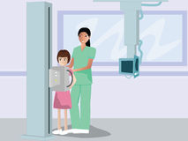 Nurse radio graphying the child patient Stock Image