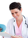 Nurse reading paper and holding a stethoscope Royalty Free Stock Image