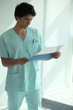 Nurse reading notes Royalty Free Stock Images