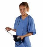 Nurse ready to take vitals. Smiling nurse ready to take someone's vital heart statistics Royalty Free Stock Images