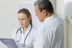 The nurse reported to doctor about medical tests. Stock Image