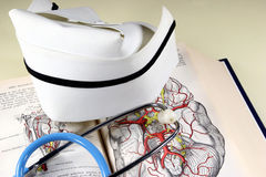 Nurse's Hat & Book. Nurse's hat, stethoscope, and anatomy book Stock Photography