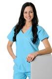 Nurse in scrubs. Nurse in light blue scrubs on white royalty free stock images