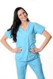 Nurse in scrubs. Nurse in light blue scrubs on white stock image