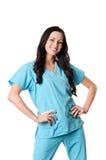 Nurse in scrubs. Smiling nurse in light blue scrubs isolated on white royalty free stock photo