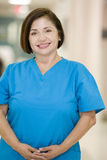 Nurse In Scrubs Standing In A Hospital Corridor Royalty Free Stock Photo