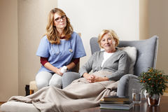 Nurse and senior patient at home Stock Photography