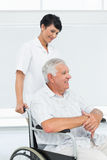 Nurse with senior patient sitting in wheelchair Stock Photography