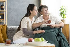 Nurse and senior woman laughing stock images