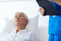 Nurse and senior woman patient at hospital Stock Image