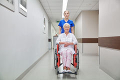 Nurse with senior woman in wheelchair at hospital Royalty Free Stock Image