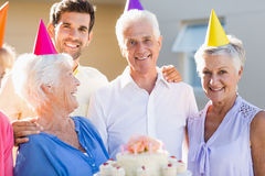 Nurse and seniors celebrating a birthday Royalty Free Stock Photography