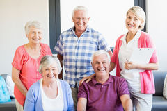Nurse and seniors standing together Stock Images