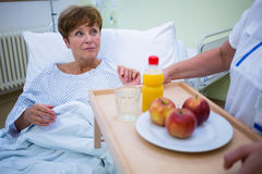 Nurse serving a breakfast to patient Stock Image