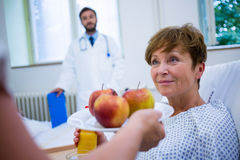 Nurse serving a breakfast to patient. In hospital Royalty Free Stock Image
