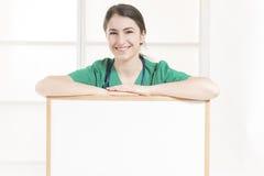 Nurse showing blank clipboard sign - medical concept stock photos