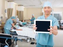 Nurse Showing Digital Tablet In Ward Stock Photo