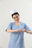 Nurse showing heart shape Stock Image