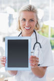 Nurse showing her digital tablet Royalty Free Stock Photo