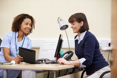 Nurse Showing Patient Test Results On Digital Tablet Stock Photography