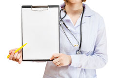 Nurse shows clipboard with blank paper isolated Royalty Free Stock Image