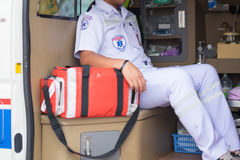 Nurse sitting at the ambulance filled with equipment prepare for Royalty Free Stock Photography