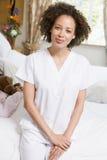 Nurse Sitting On Hospital Bed Stock Photos