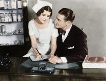 Nurse Sitting On The Doctor S Lap Royalty Free Stock Photos