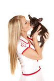 Nurse with small dog hold kiss Stock Photography