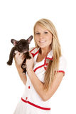 Nurse with small dog hold look Royalty Free Stock Photo