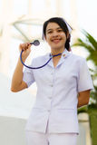 Nurse smiling with stethoscope Royalty Free Stock Photos