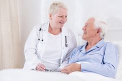 Nurse smiling to her senior patient Royalty Free Stock Photo